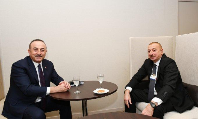 Prezident İlham Əliyev Davosda Türkiyənin Xarici İşlər naziri ilə görüşüb